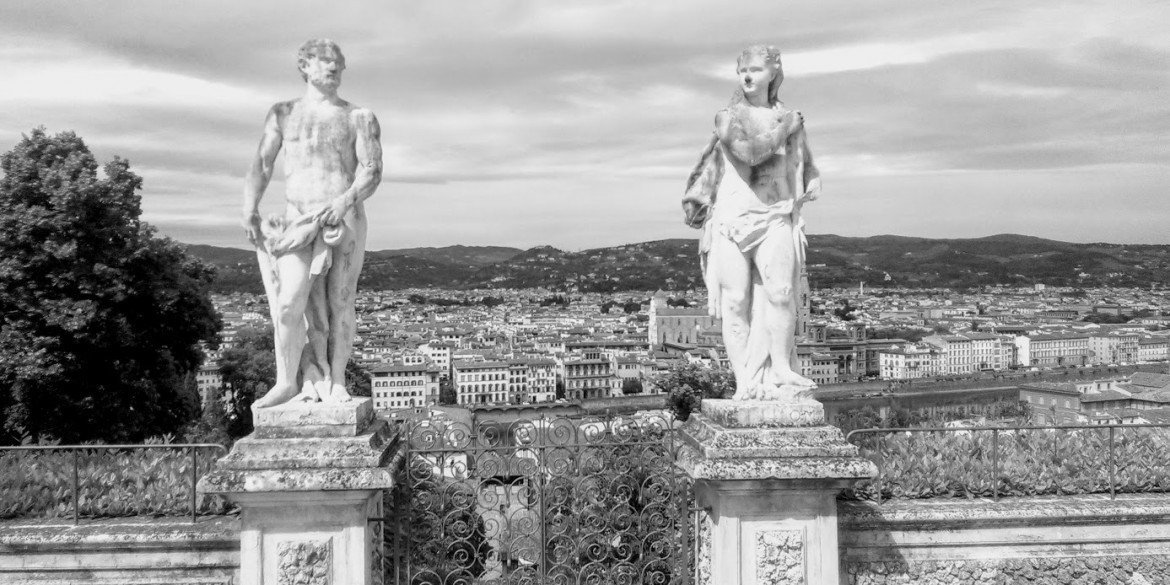 statues of man and woman on hilltop in Florence, italy