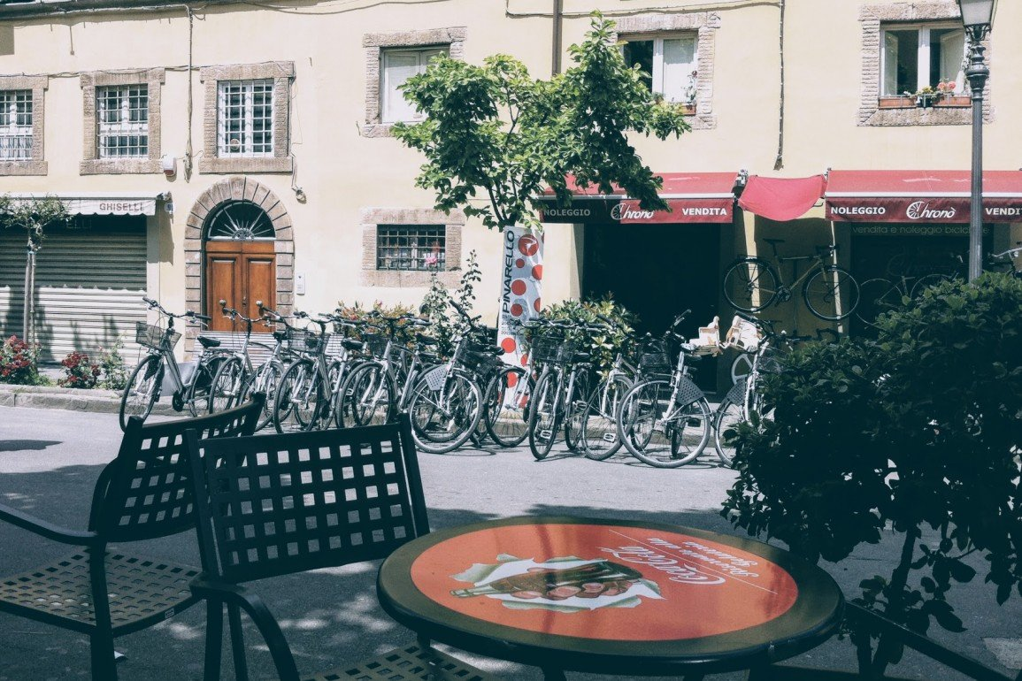 view across cafe table at many bicycles in Lucca, Italy