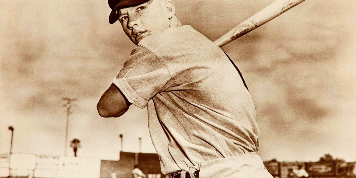 New York Yankee baseball player Mickey Mantle in 1951 posing with bat