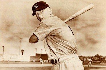 New York Yankee baseball player Mickey Mantle in 1951 posing with bat