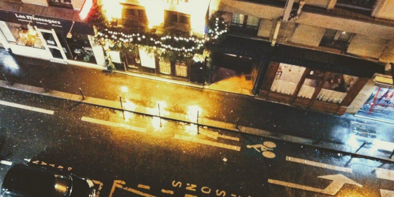 looking down at empty Paris street at night