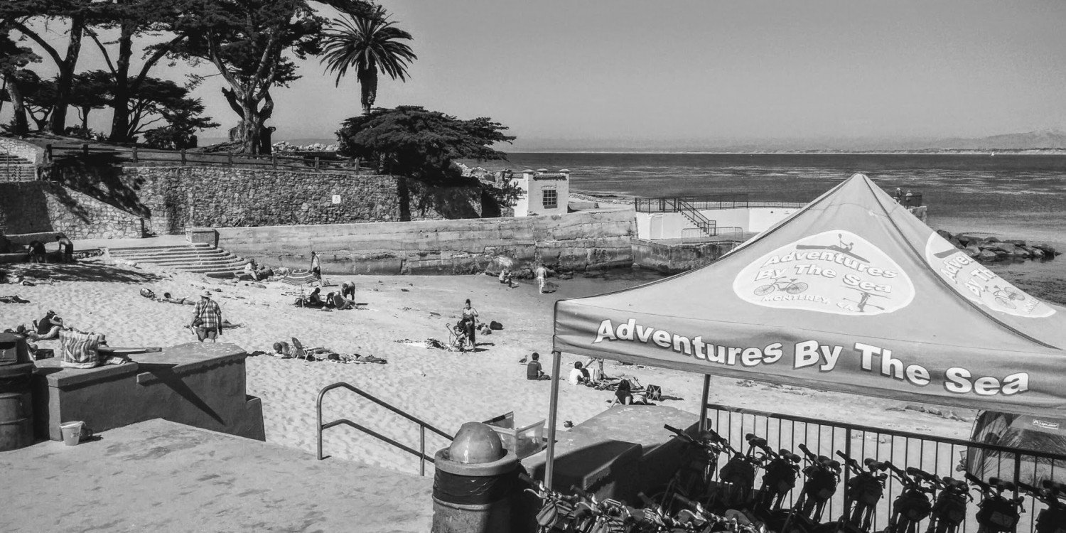 sandy beach in Monterey, California with bicycle rental tent