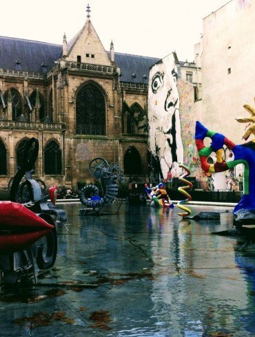 outdoor square in Paris with colorful works of surrealist art