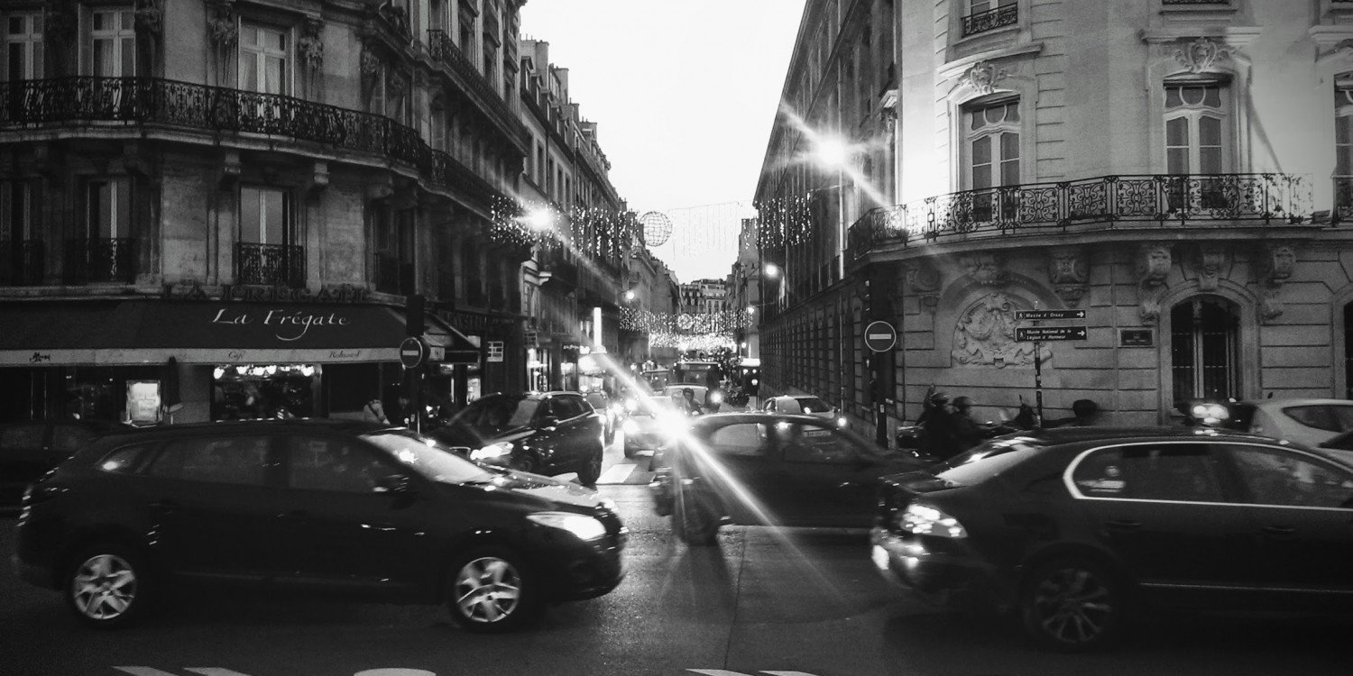 Paris street at night with cars and lights