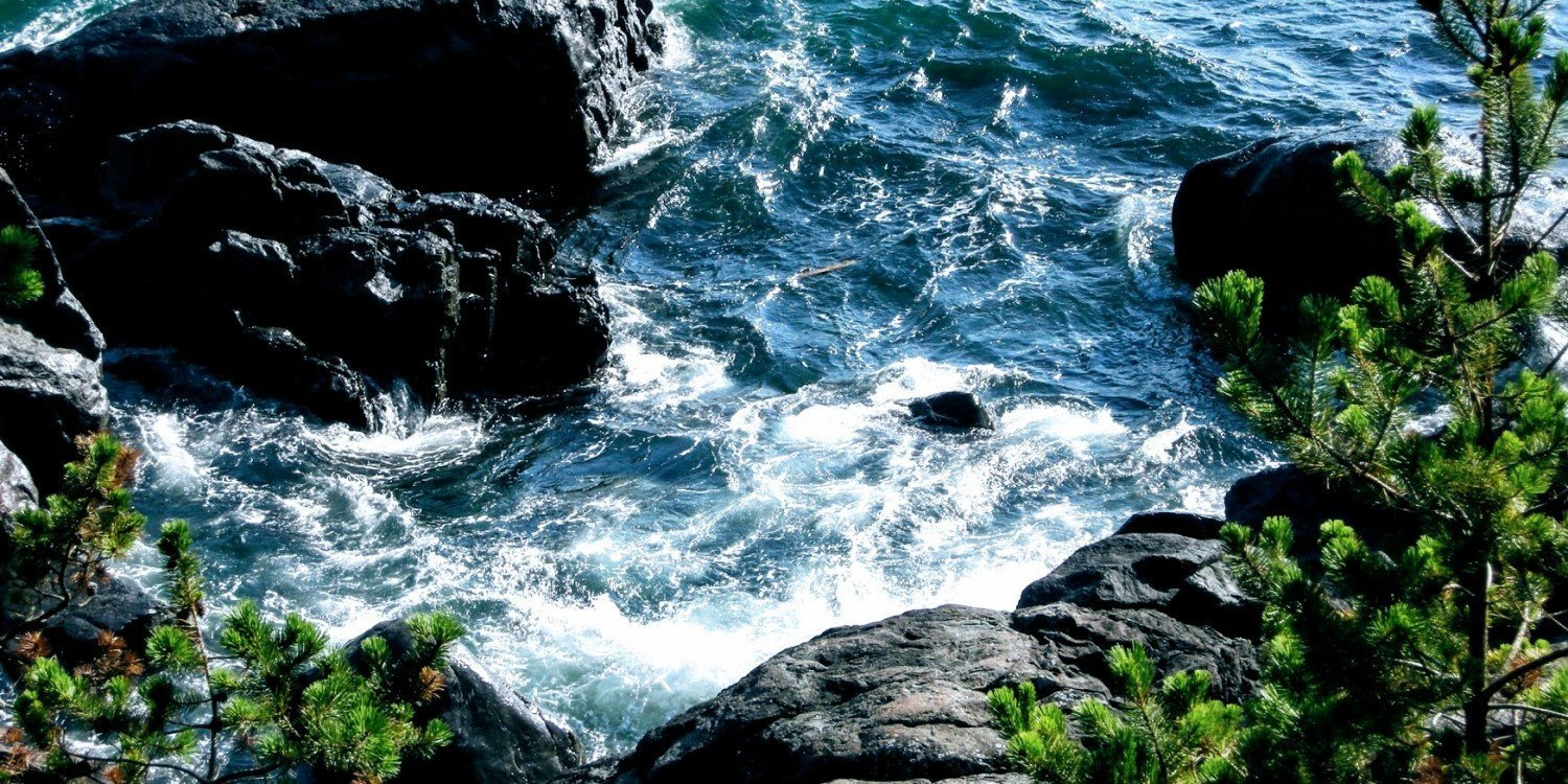 frothy white water and wet rocks