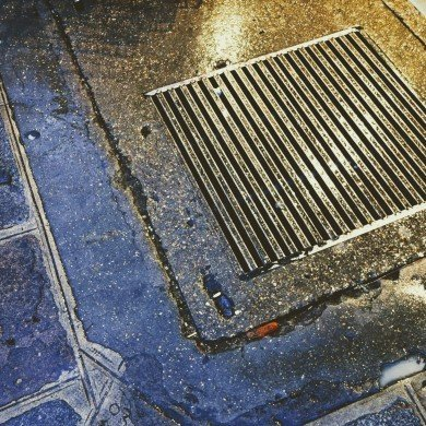 close up of subway grate in street