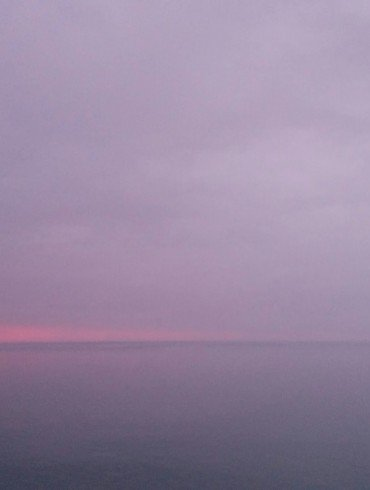 sunset and purple sky across water