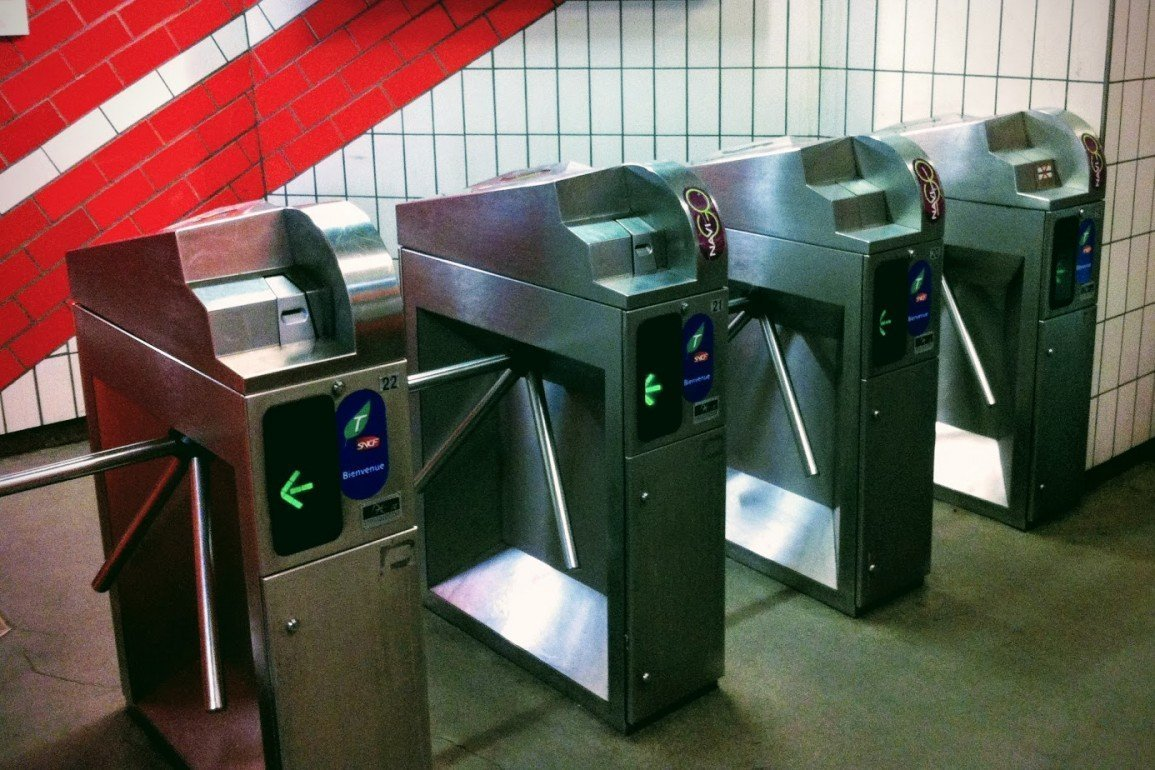 pay machines and turnstiles in Paris subway