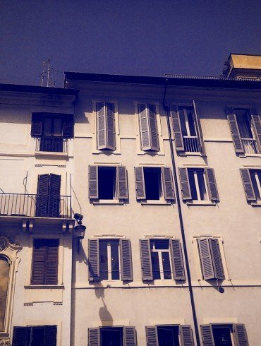 exterior of building in Venice with many dark windows