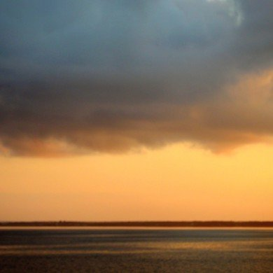 yellow sky with dark clouds