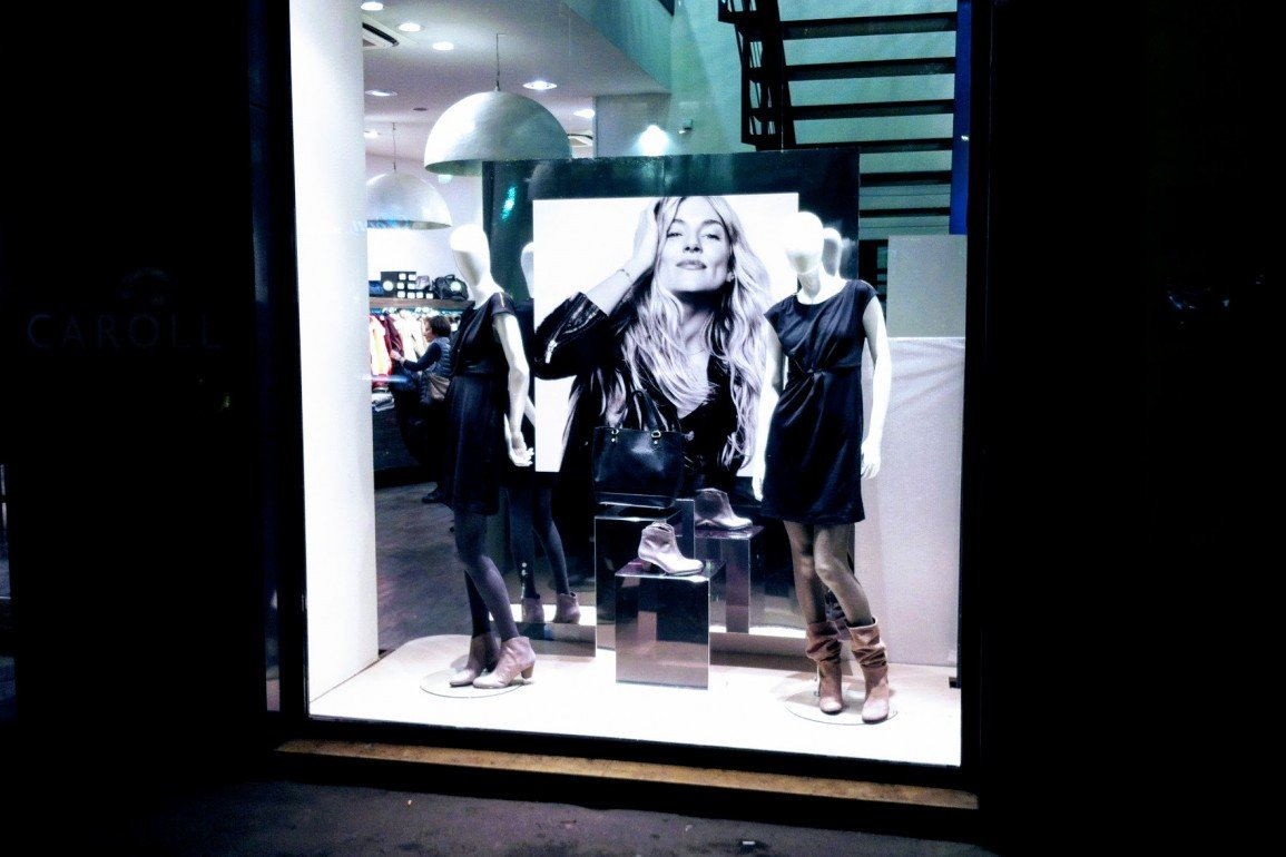 upscale shop window in Paris displaying women's clothing