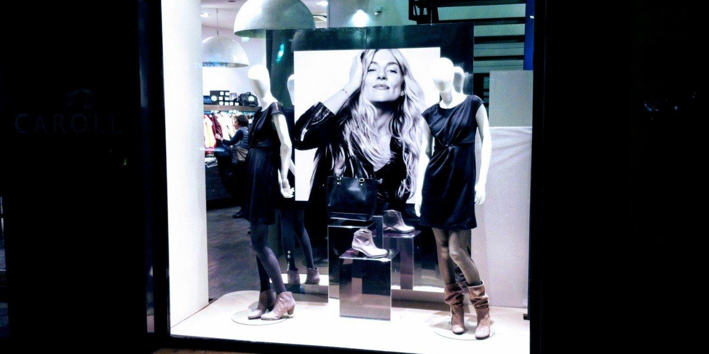 upscale shop window in Paris displaying women's clothing