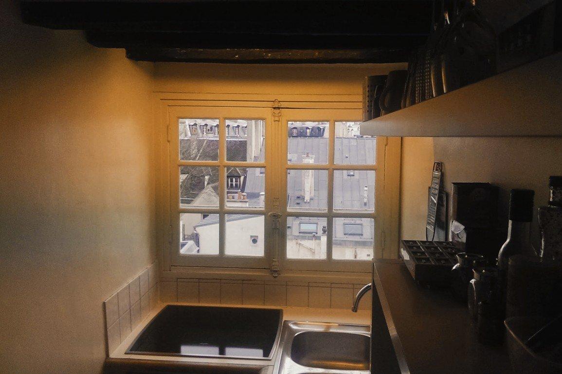 interior of kitchen overlooking Paris rooftops