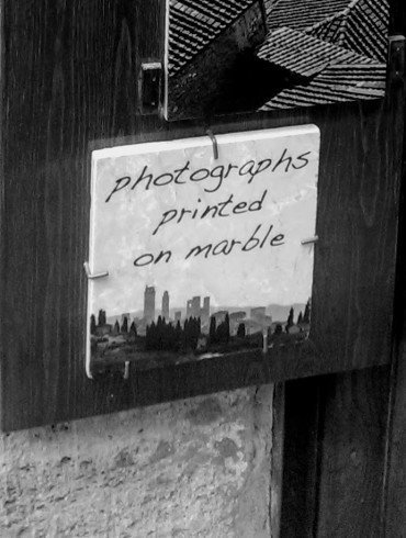 sign on marble tile says, photographs printed on marble