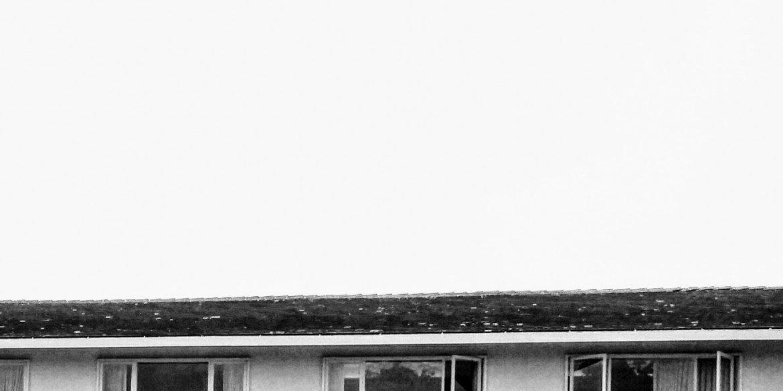 roofline of motel against a white sky