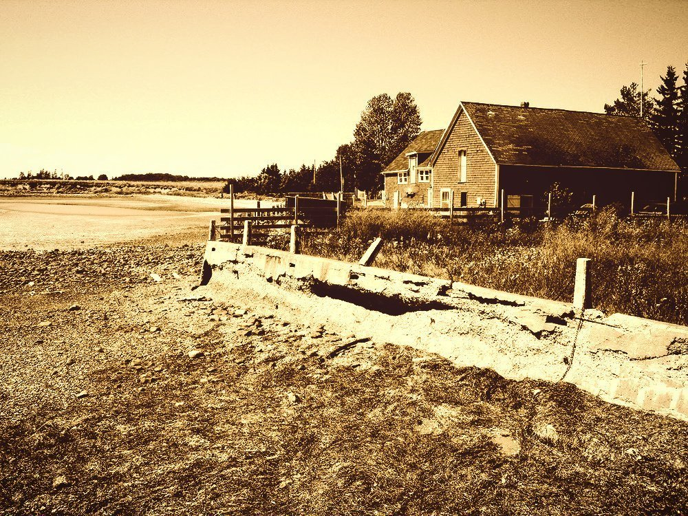 farmhouse beside dry lake bed