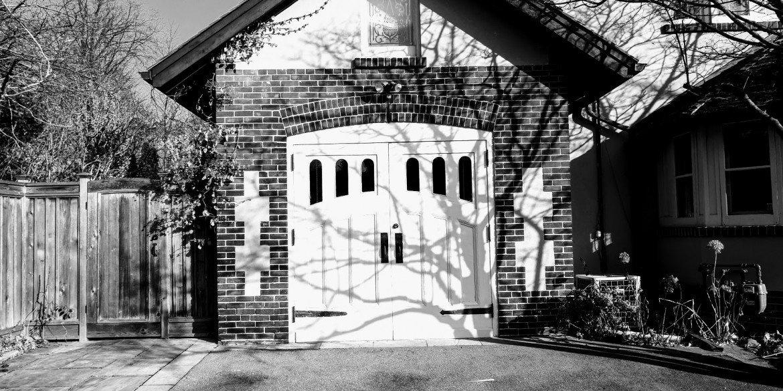 white double doors in brick garage