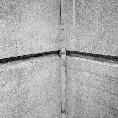 two concrete walls joining with sealant in crack