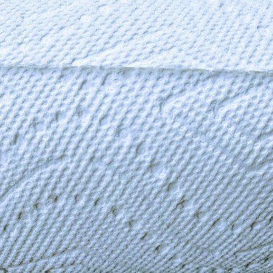 close up of white paper towel with pattern indentations