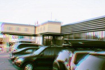 out of focus vehicles in parking lot of motel