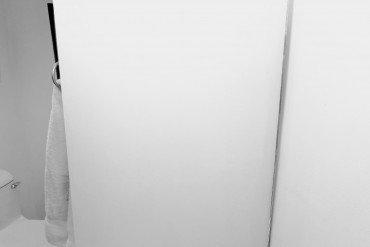bathroom door partly open to reveal handle of toilet