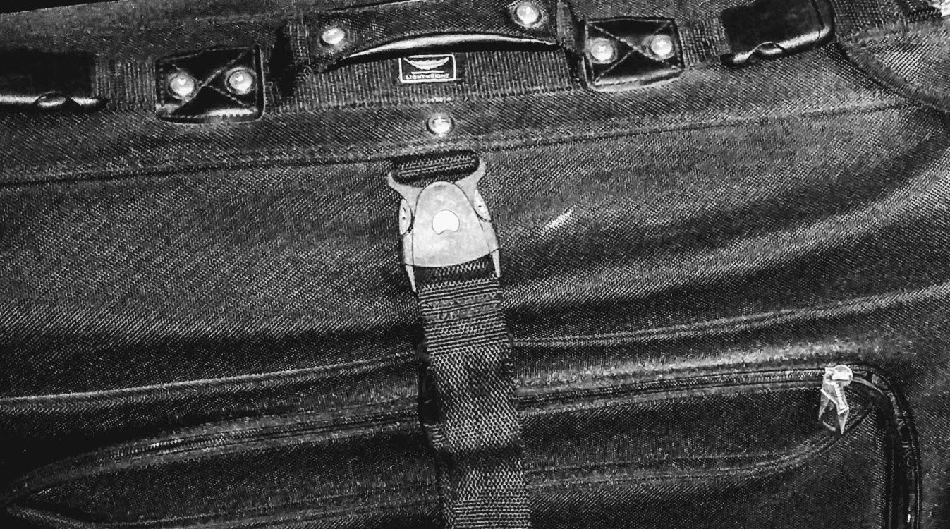 close up of handle of black travel bag