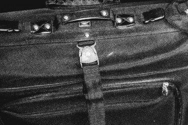 close up of handle of black travel bag