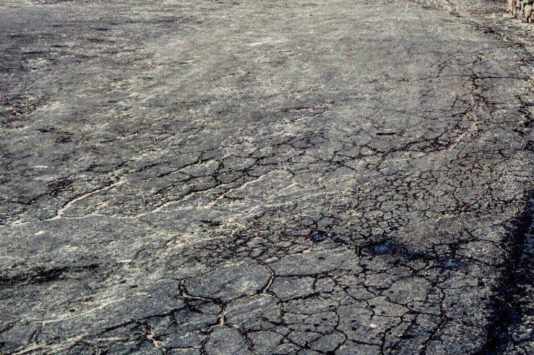 heaving cracked pavement