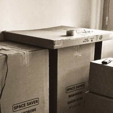 room full of large cardboard packing boxes with the words, space saver, in view