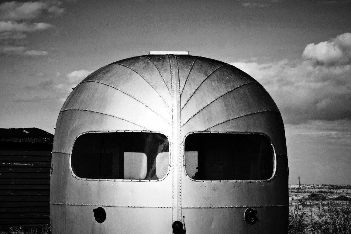 sleek camper trailer with two windows looking like eyes watching us