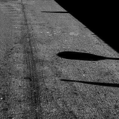 shadows on old black pavement
