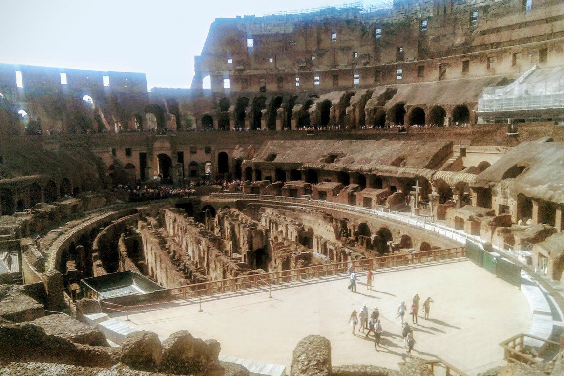interior of Roman Colosseum shows travertine, tuff, and brick-faced concrete