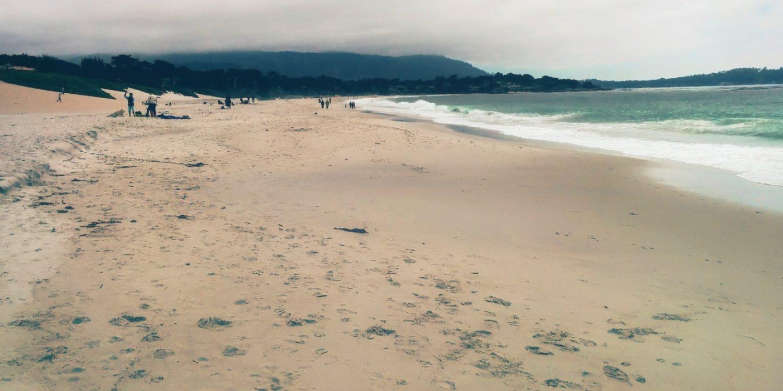 wide sandy beach in Carmel, California, as waves roll in