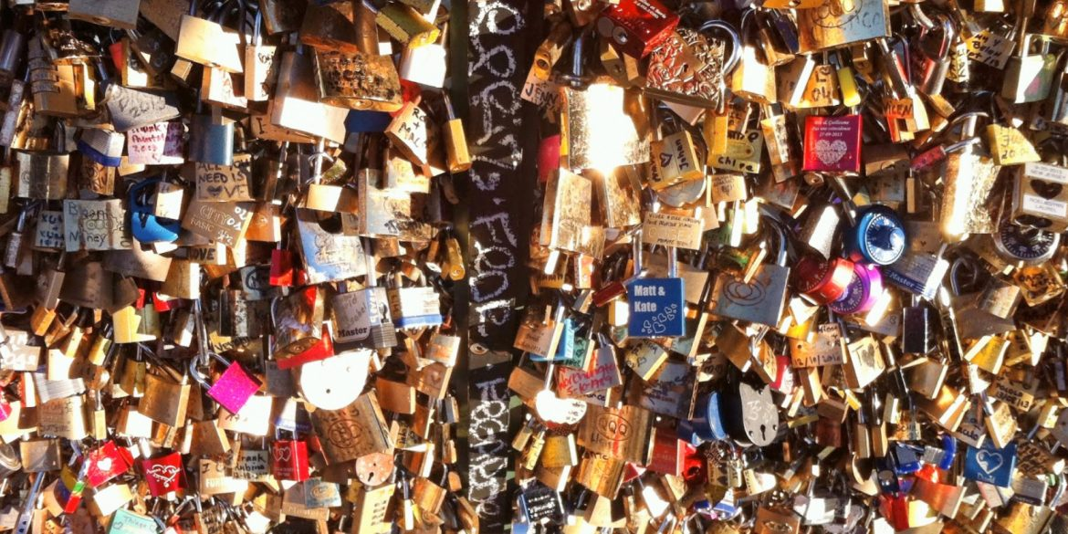 hundreds of padlocks, called love locks, of all shapes and sizes