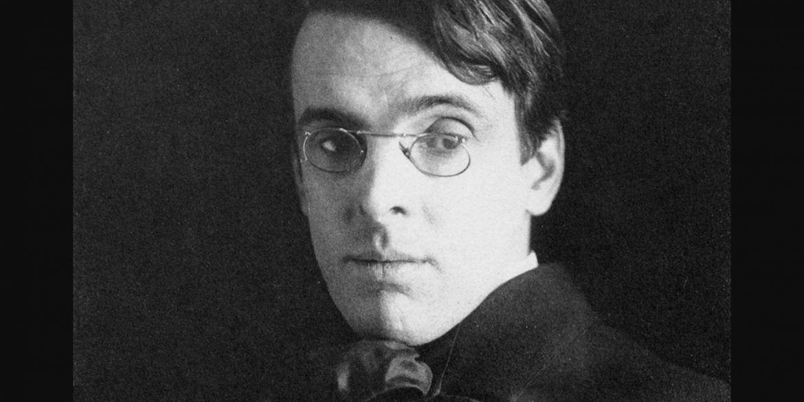 Photograph of the poet W. B. Yeats wearing small round eyeglasses