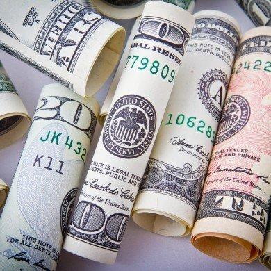 many rolls of American cash paper money