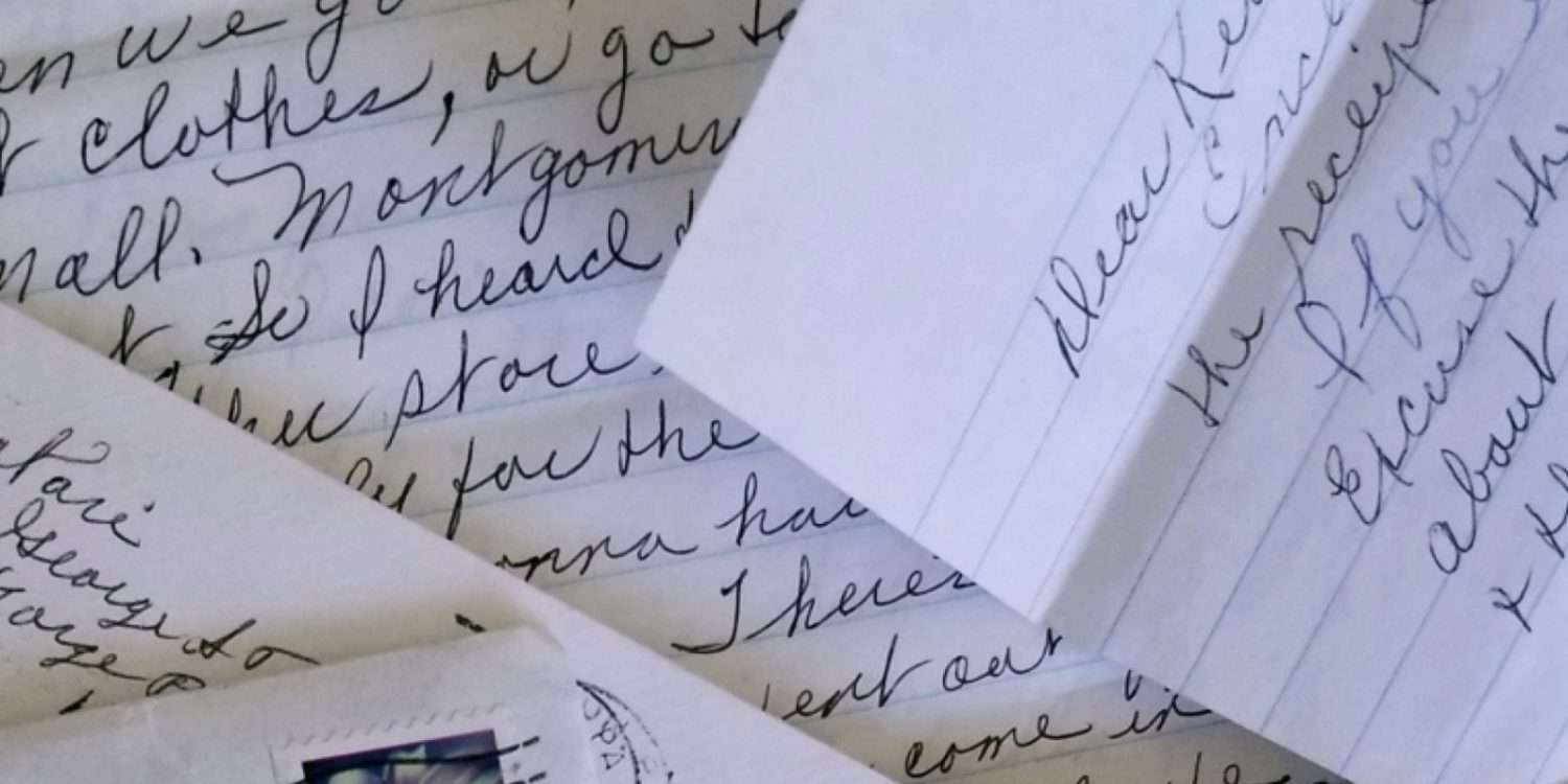 several pages of a handwritten letter on blue lined paper