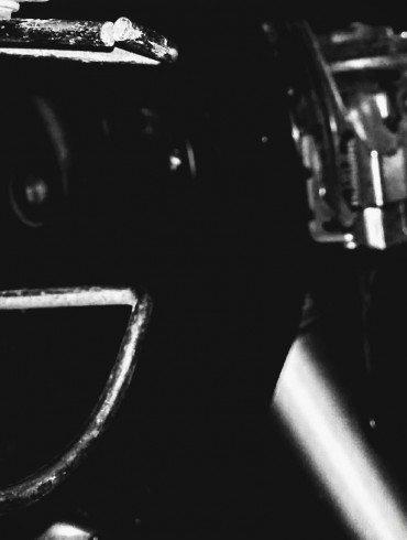 steel machine parts against black background