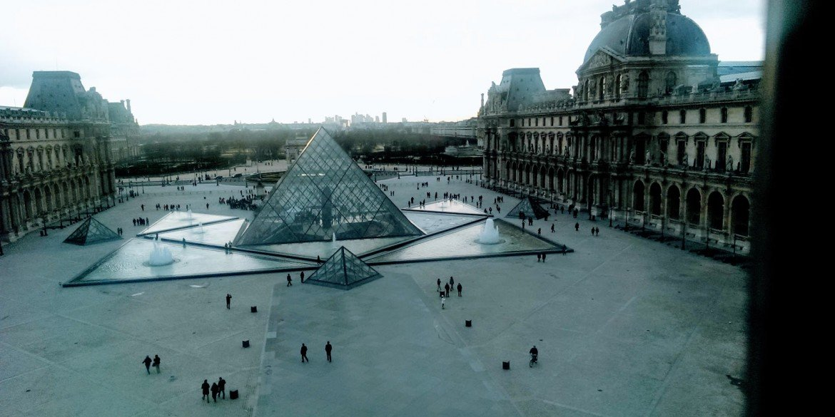 glass pyramid in the courtyard of the Louvre Museum in Paris