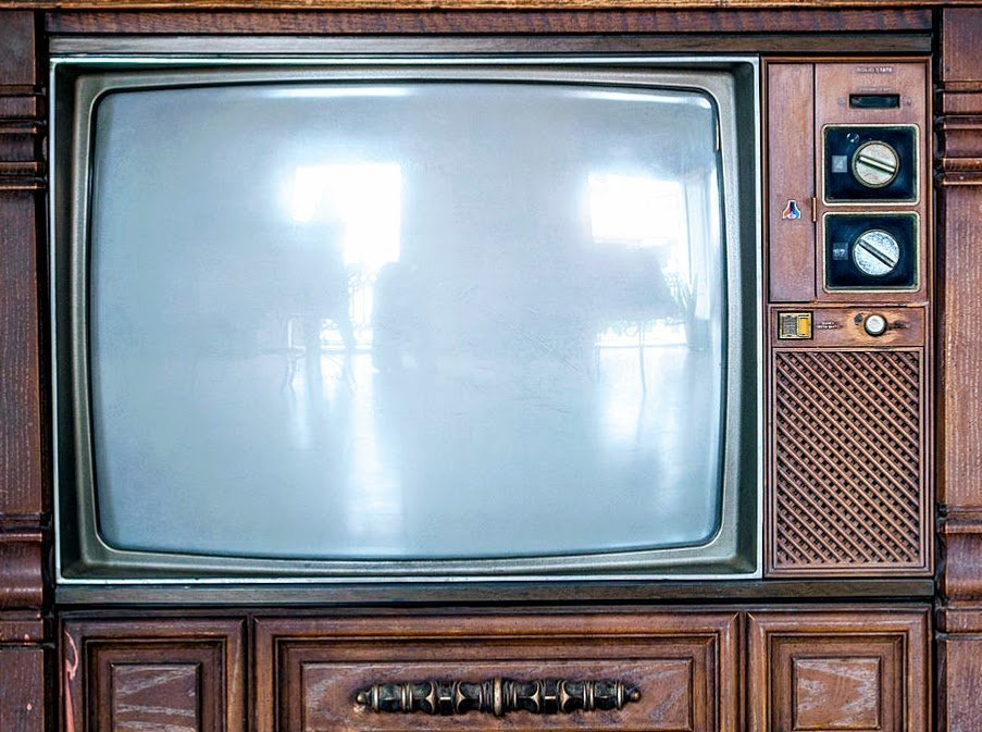 old TV set in ornate wood console