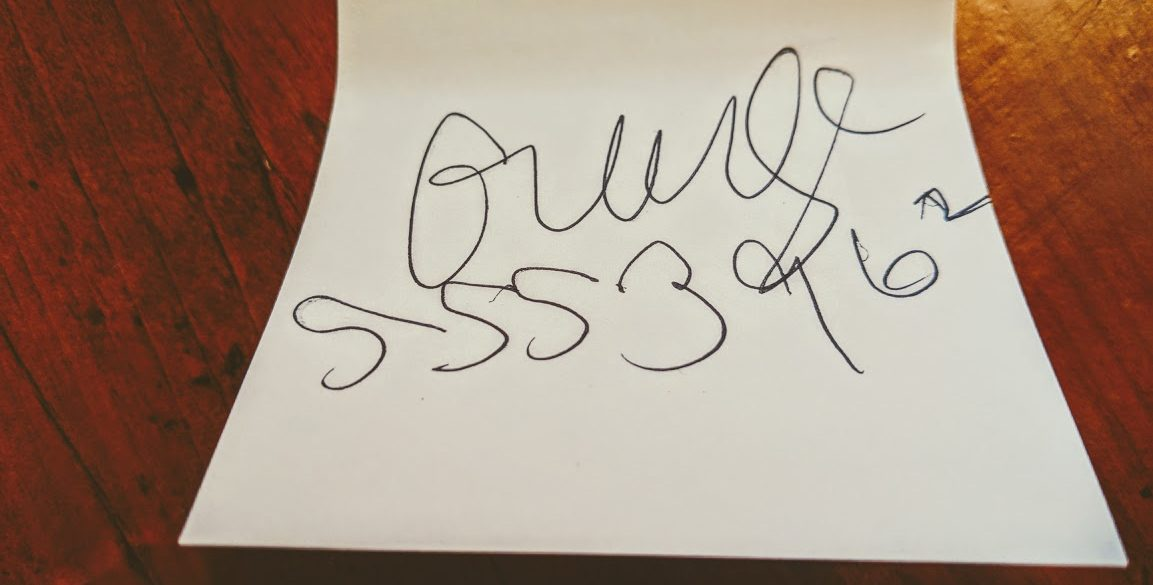 sticky note with a name scrawled on it that could be George or grudge