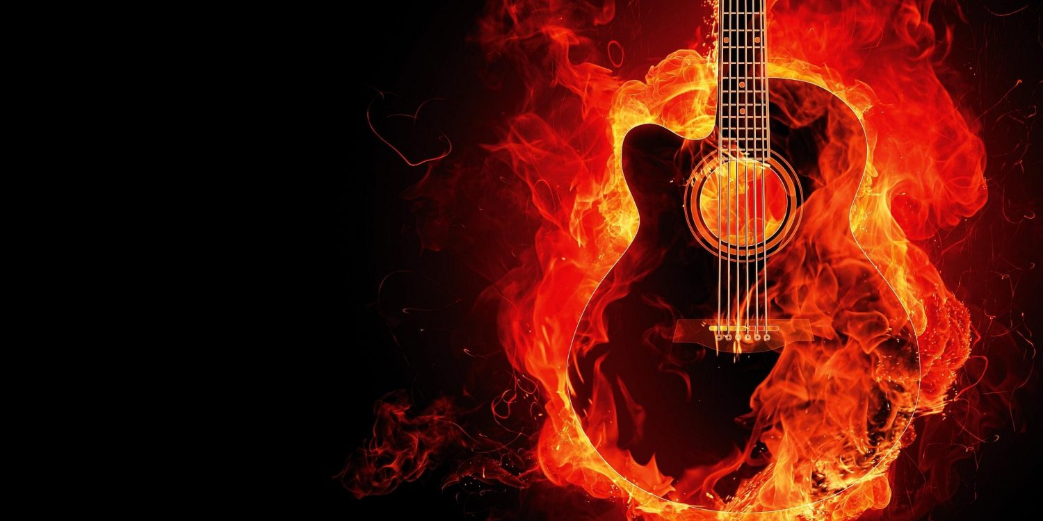 guitar on fire in orange flames