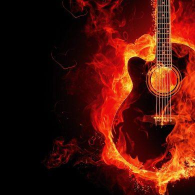 guitar on fire in orange flames