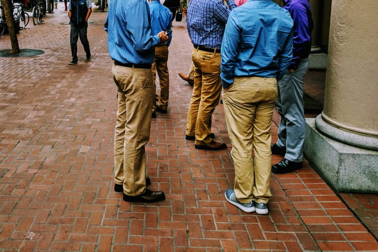 group of young men wearing tan chino trousers on street in Sn Francisco