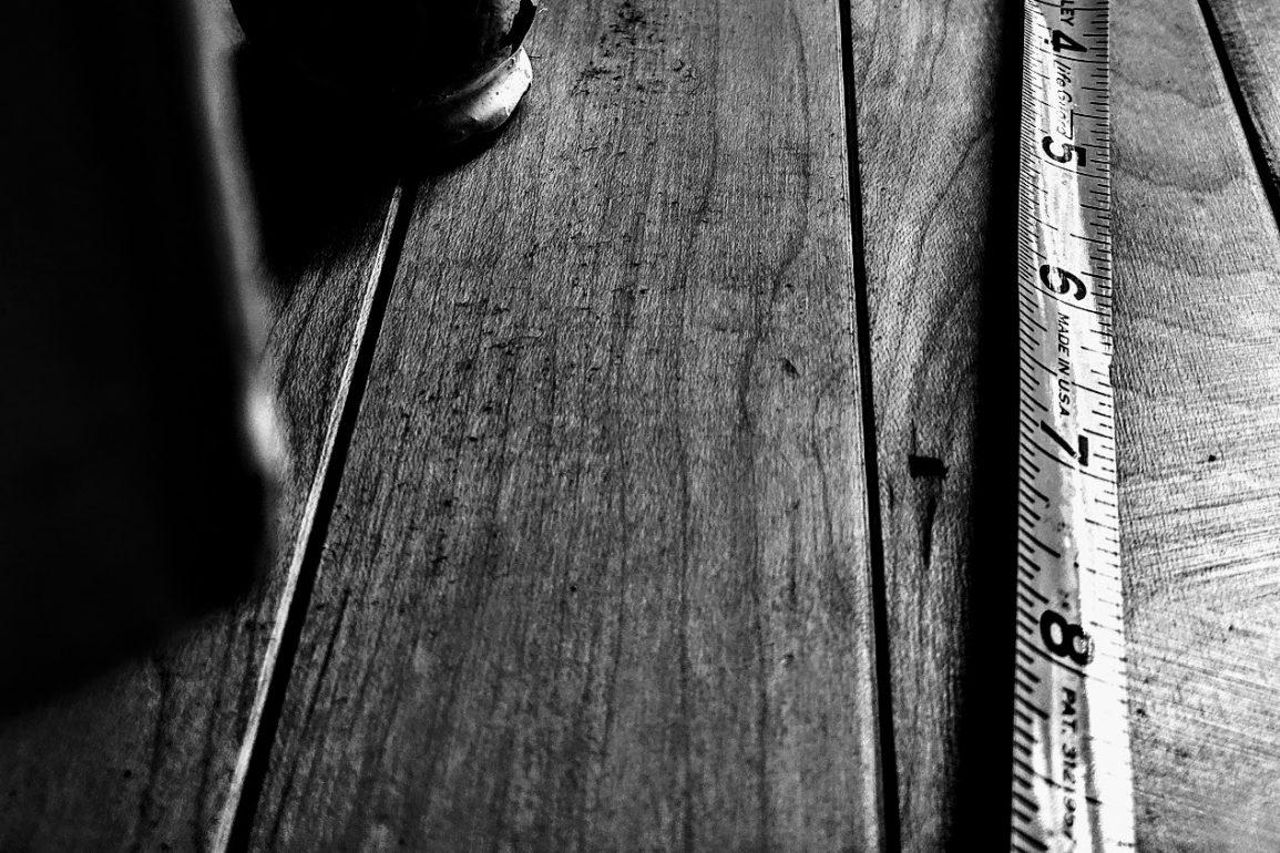 tape measure on wood floor