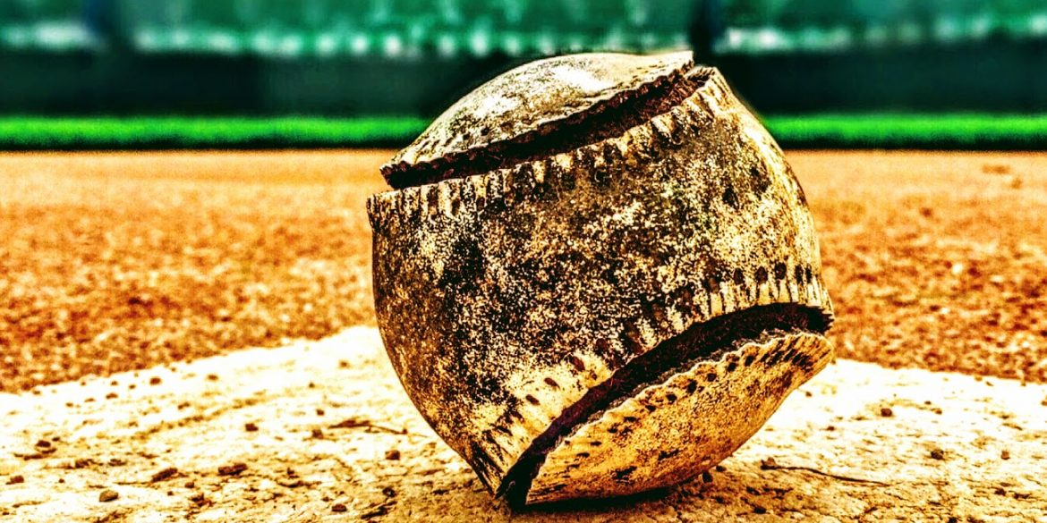 tattered old baseball with split seams