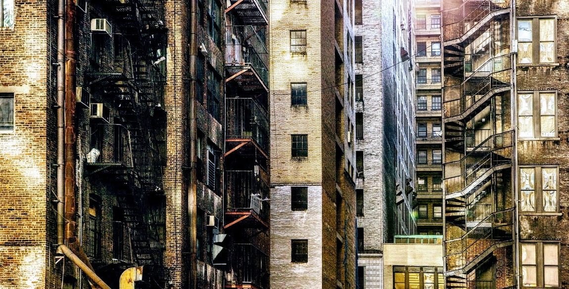 several apartment building exteriors with fire escapes
