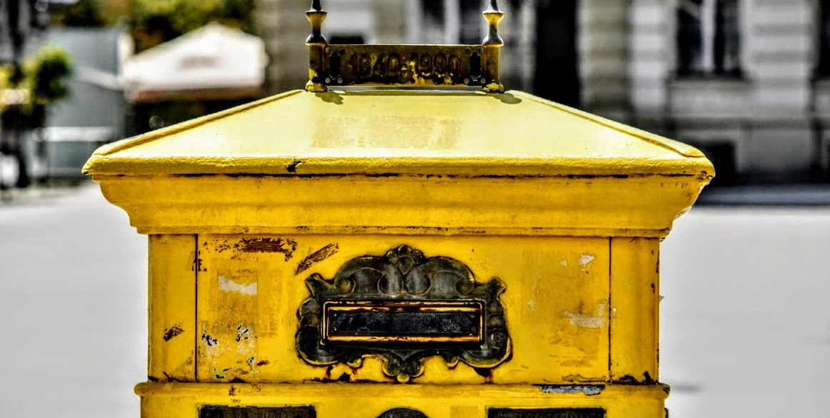 yellow mailbox on street