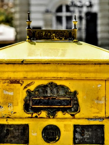 yellow mailbox on street