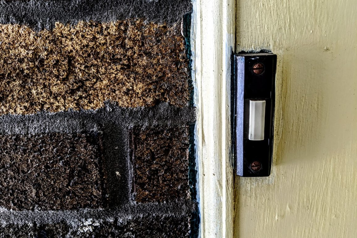 doorbell and brick wall